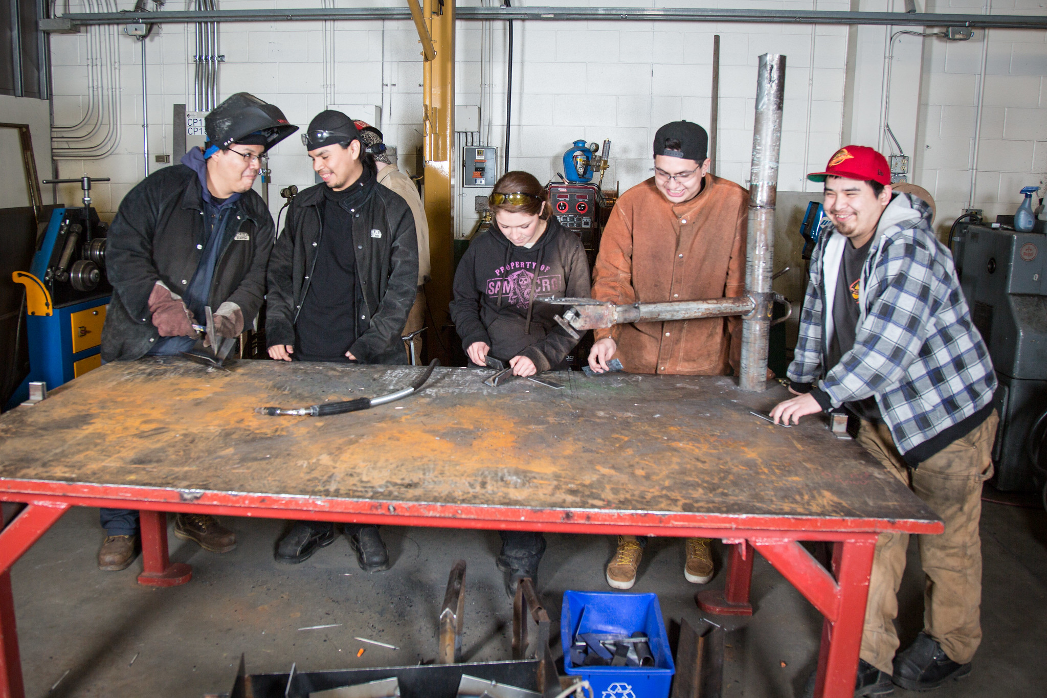 group of students around work bench